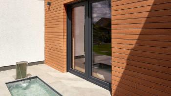planeo Fassado - WPC revêtement de façade en losange brun ambré